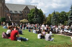 Tyler Stauffer photo: After the mass, the Mercyhurst College community enjoyed a picnic lunch in front of Old Main.